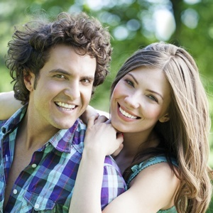 A happy couple smiling because their dentist in Maple, ON offers a convenient dental experience