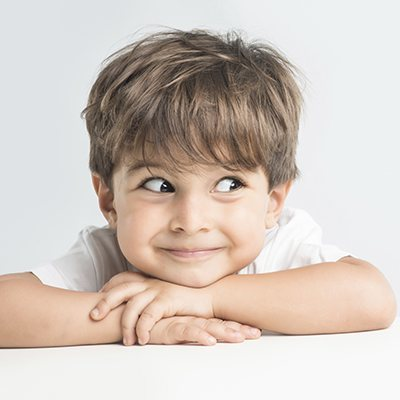Family Dentistry in Maple, ON - Adorable little boy with shaggy brown hair making a funny face. We offer children's dentistry in Maple Ontario.