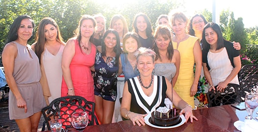 Our dentist in Maple, ON and her amazing dental team gathered around R. Gillmore to celebrate.