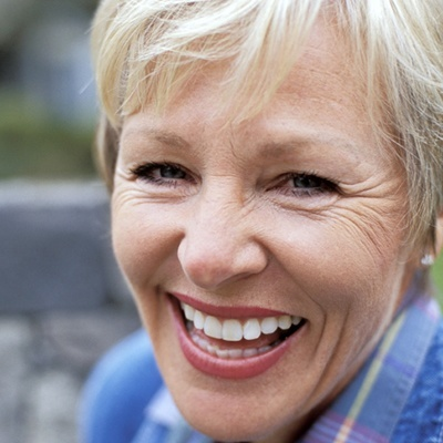 Family Dentistry in Maple, ON - Periodontal scaling - An older woman laughing with a bright beautiful smile.